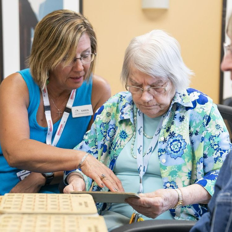 ABBOTSFORD,BC:JUNE 1, 2017 -- Karen Baillie (left) CEO of Menno Place, plays bingo game with Anne Braun at Menno Place in Abbotsford, BC, June, 1, 2017. Menno Place is a seniors care facility with multiple levels of care. (Richard Lam/PNG) (For ) 00053506A [PNG Merlin Archive]